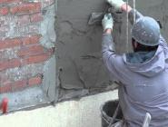 Капремонт жилья: для фасадов применяют механизированное нанесение штукатурки